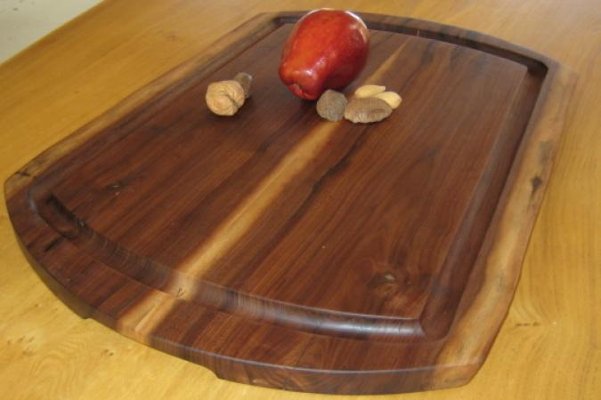 "The Carving and Serving Platter measures about 15"" x 21"" x 1"", (each one is a slightly different shape) and is made from reclaimed black walnut. It features a generous ""juice groove"" to keep the drippings where they belong, and handle cutouts for easy lifting. It is big enough to accommodate the largest ""Roast Beast"" for carving and serving in style."