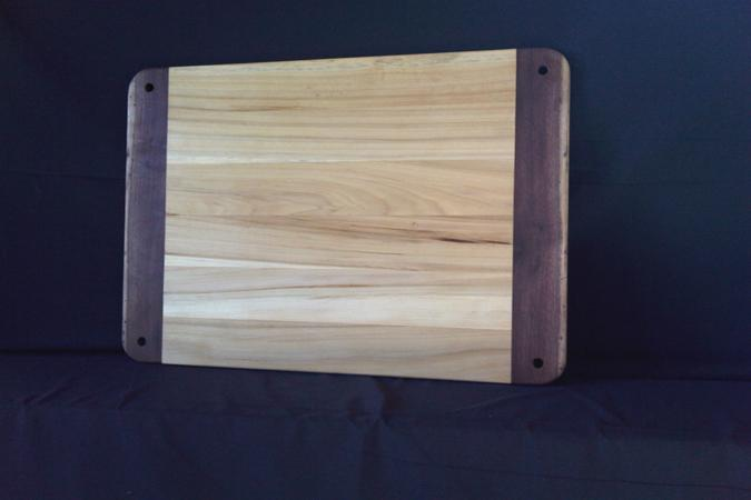 "This large board for preparing dough, and rolling out pastry crusts and so forth measures 29"" x 22"" by .75"". It is lightweight (for its size) and strong, allowing easy cleanup and storage. Made from sustainably harvested cottonwood and black walnut. Finished with three coats of walnut oil and beeswax."