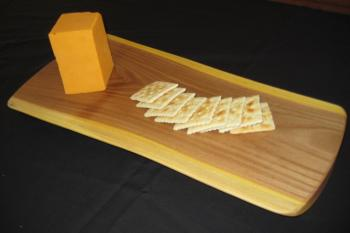 """The cheese board in reclaimed elm (7"""" x 16"""" x 1""""). These boards in elm, or black walnut are the perfect size for setting out snacks for your guests. With their elegant, organic shapes , beautiful grain and color, this is a great way to present these reclaimed trees to your friends and family."""